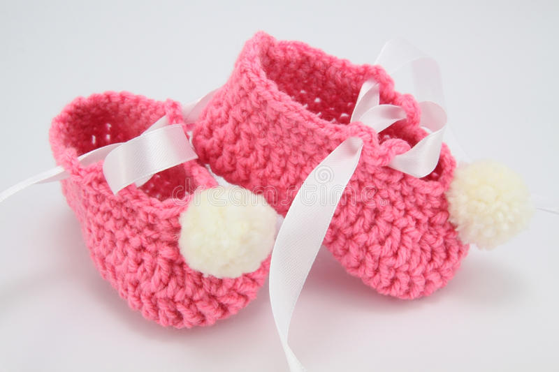 Knitted shoes for young children royalty free stock photo