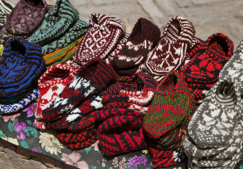 Knitted slippers in a street market, Uzbekistan. Street market with knitted slippers, Khiva, Uzbekistan royalty free stock photos