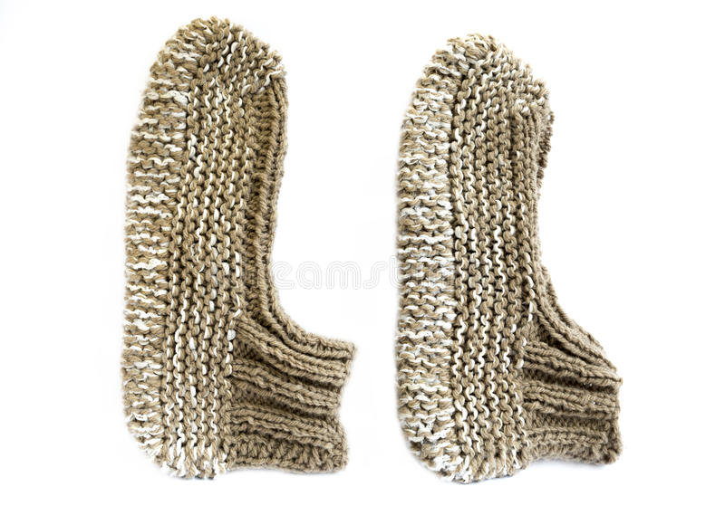 Knitted slippers. Traditional Bulgarian knitted slippers isolated on white royalty free stock photo