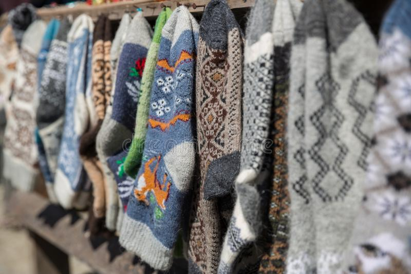 Knitted socks and slippers, Georgia. Street market with knitted socks and slippers,.  royalty free stock photography
