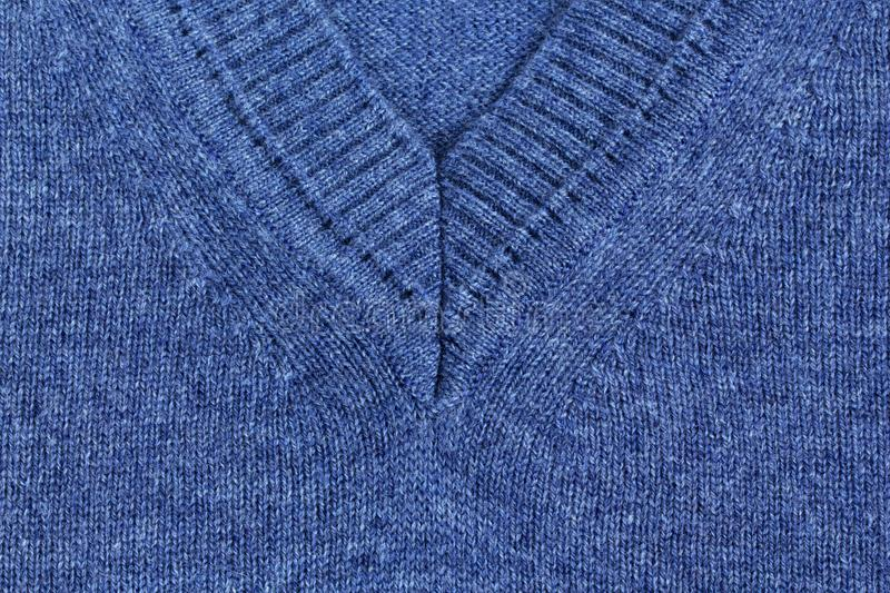 Knitted sweater, closeup neutral background. Knitted blue sweater, closeup neutral background stock photos