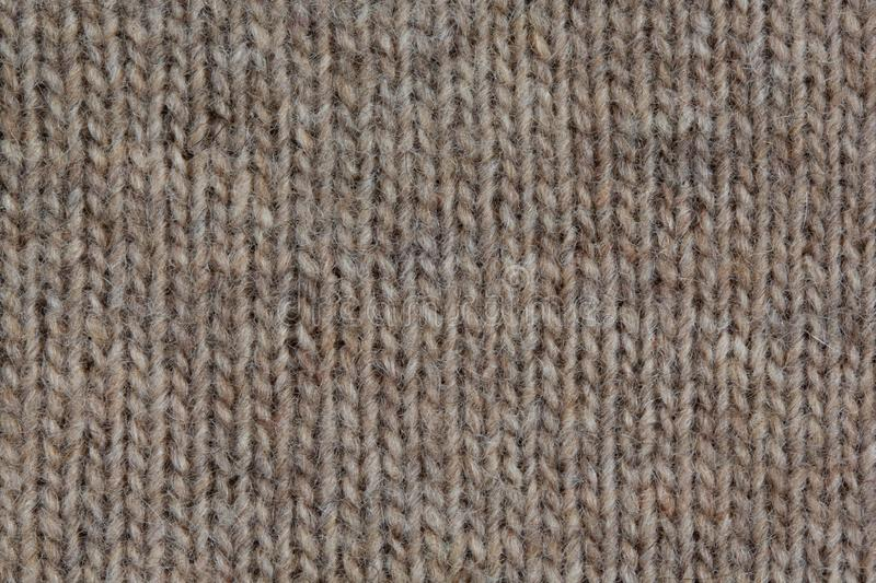 Knitted sweater, closeup neutral background. Knitted beige sweater, closeup neutral background royalty free stock photo
