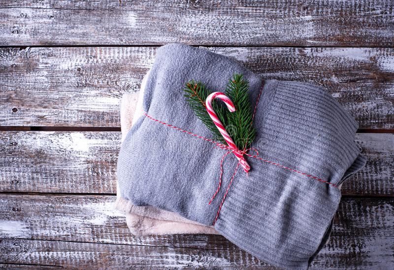 Knitted sweaters on wooden background stock photography