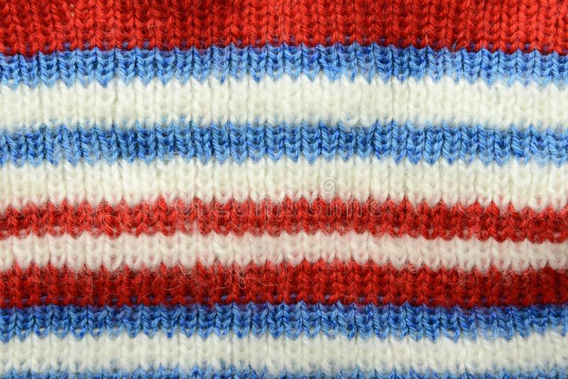 Knitted textile background full frame in red white blue color royalty free stock photos