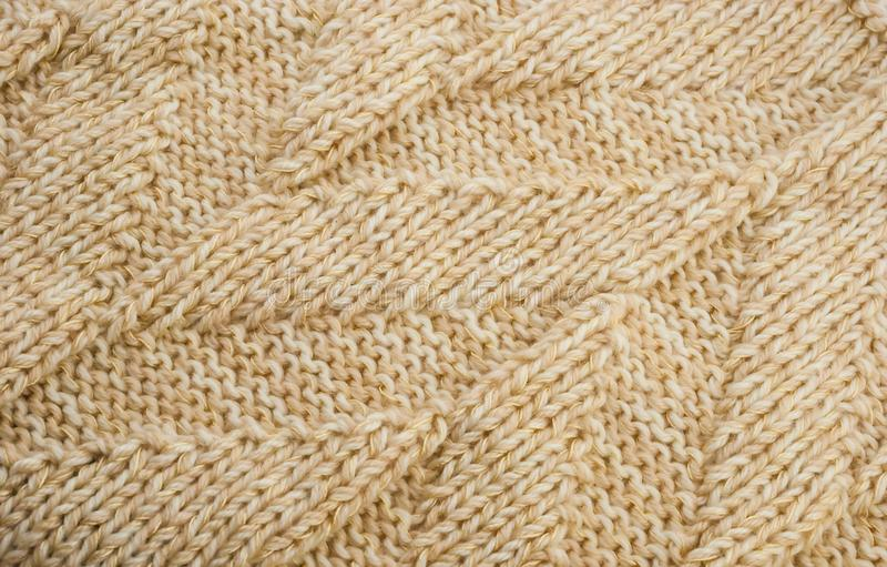 Knitted texture beige thread stock photo