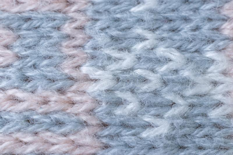 Knitted texture closeup. Visible yarn and fiber. The image is suitable as a background for various tasks stock photo