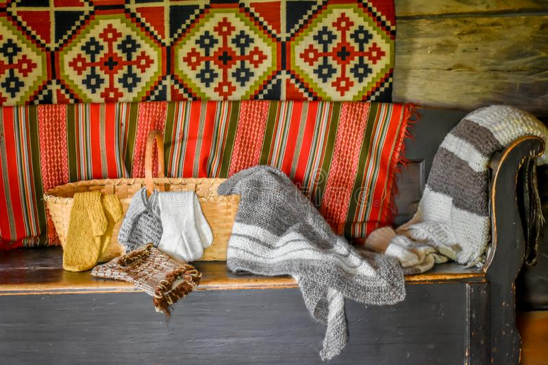 Knitted Wool Blankets on a Wooden Couch stock photos