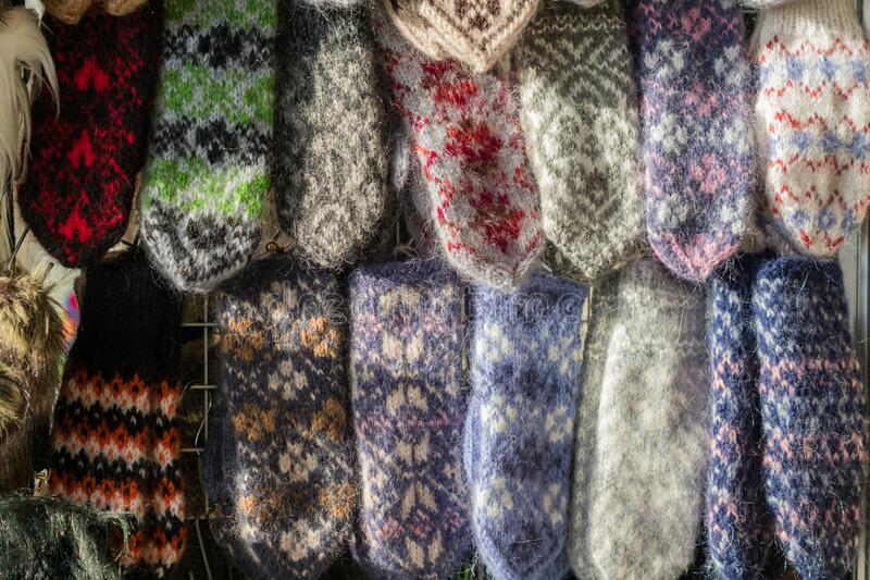 Knitted wool mittens background. Winter clothes accesories.  stock image