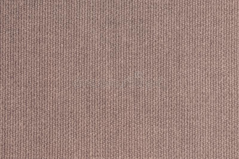 Knitted woolen fabric of gray red color stock images