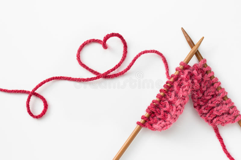 Knitting. Incomplete knitting project with wooden needles stock image