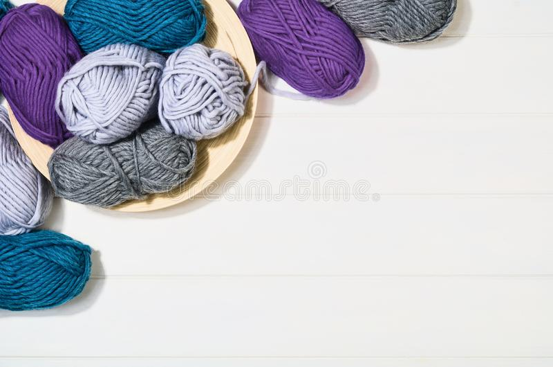 Knitting accessories top view on white wooden background royalty free stock image