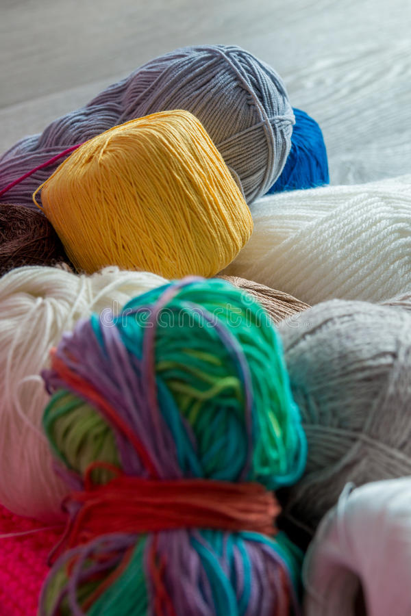 Knitting background. Close up. Group of yarn and needles on table. Top view. Knitting background. Close up. Group of yarn and needles on table stock photo
