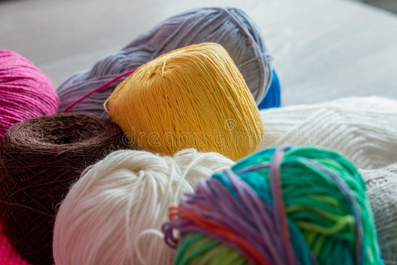 Knitting background. Close up. Group of yarn and needles on table. Top view. Knitting background. Close up. Group of yarn and needles on table royalty free stock images