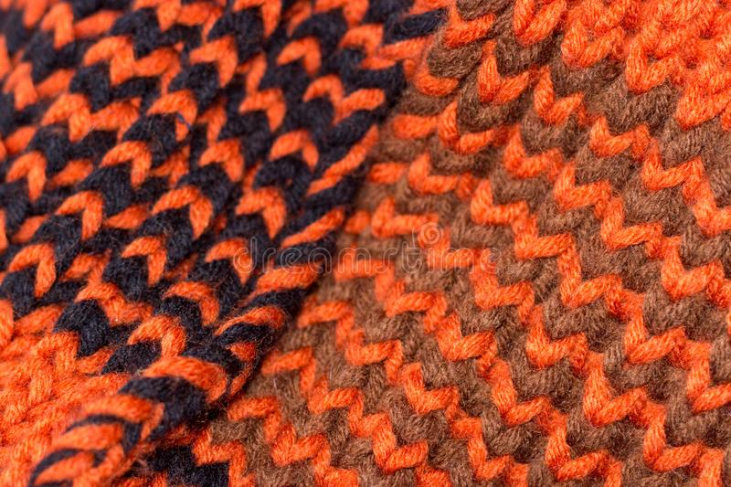 Knitting. Background knitted texture. Bright knitting needles. Orange and black wool yarn for knitting royalty free stock photography