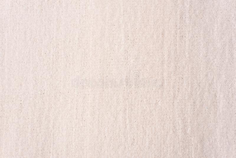 Knitting background texture light beige color. Fabric textile background.  stock photography