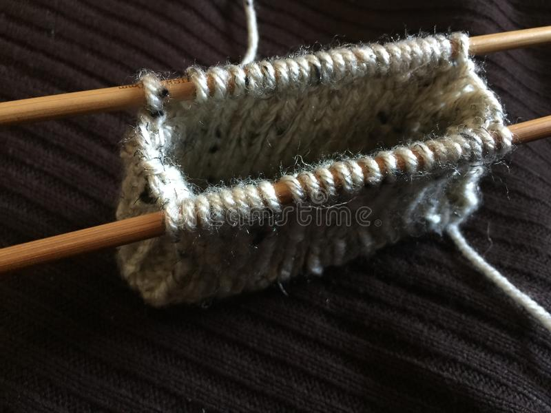 Knitting Coin Purse With 2 Bamboo Needles Stock Photo