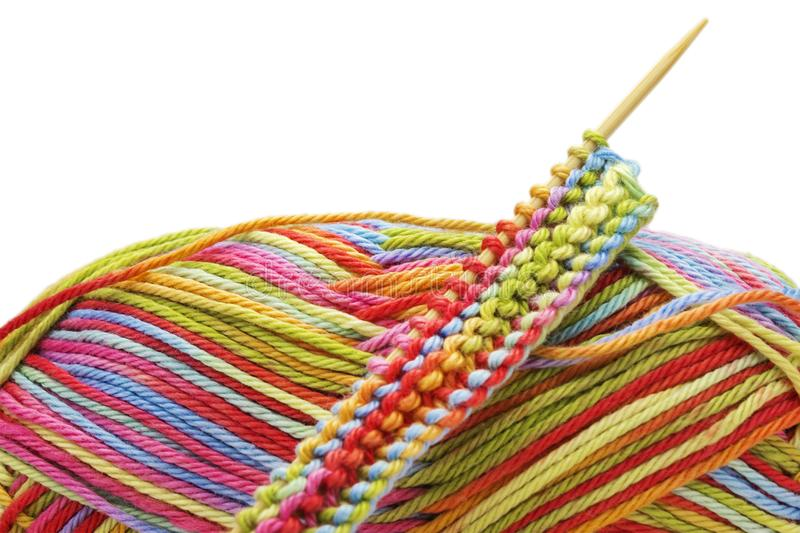Knitting colorful melange rainbow cotton ball and knitting needles isolated on white background. The beginning of comfort knit clo. Th. Place for text, copyspace stock photos