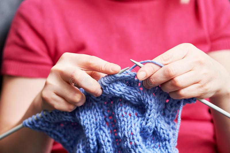 Knitting. female hands with needle and thread stock image