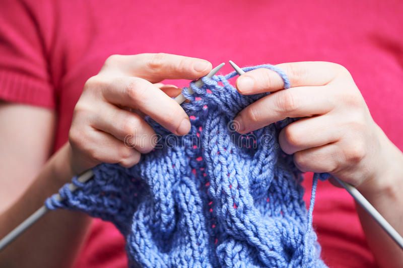 Knitting. female hands with needle and thread royalty free stock photos