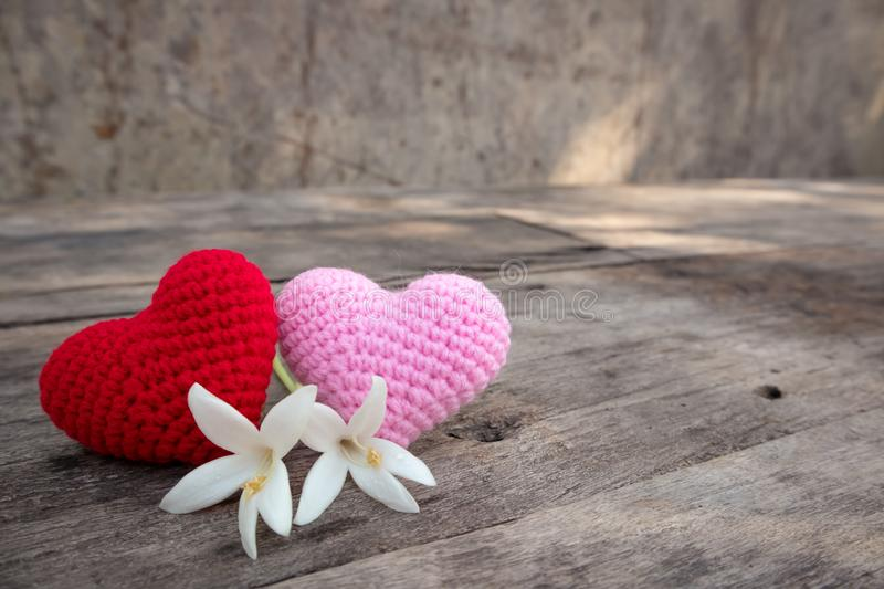 Knitting hearts with Millingonia on wooden table stock photos
