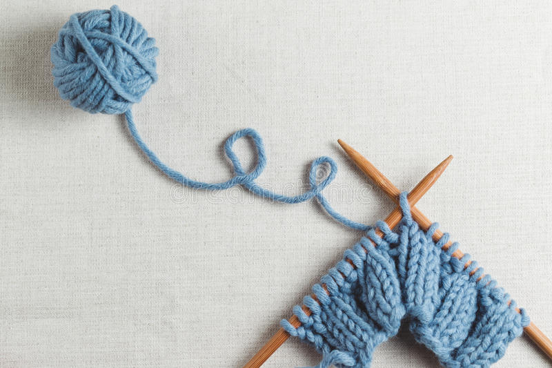 Knitting. Incomplete knitting project with wooden needles royalty free stock image