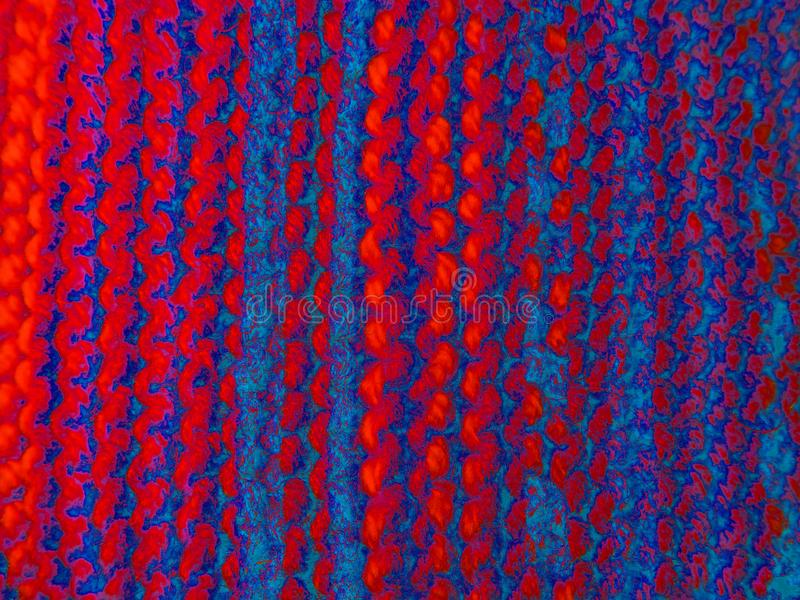 Knitting. Knitted fabric. Knitting texture. Background image. Hobbies leisure crafts. Acid colors royalty free stock image