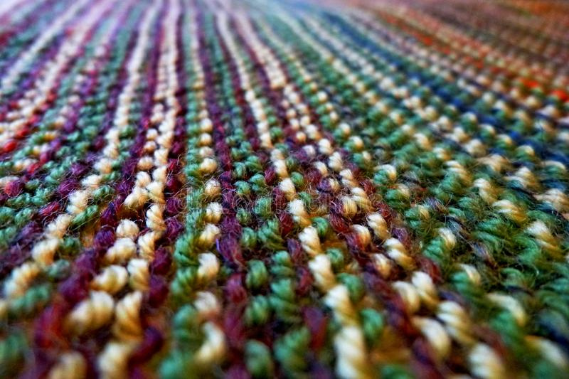 Knitting. Knitted multicolored fabric. Knitting texture. Background image. Hobbies leisure crafts stock photography