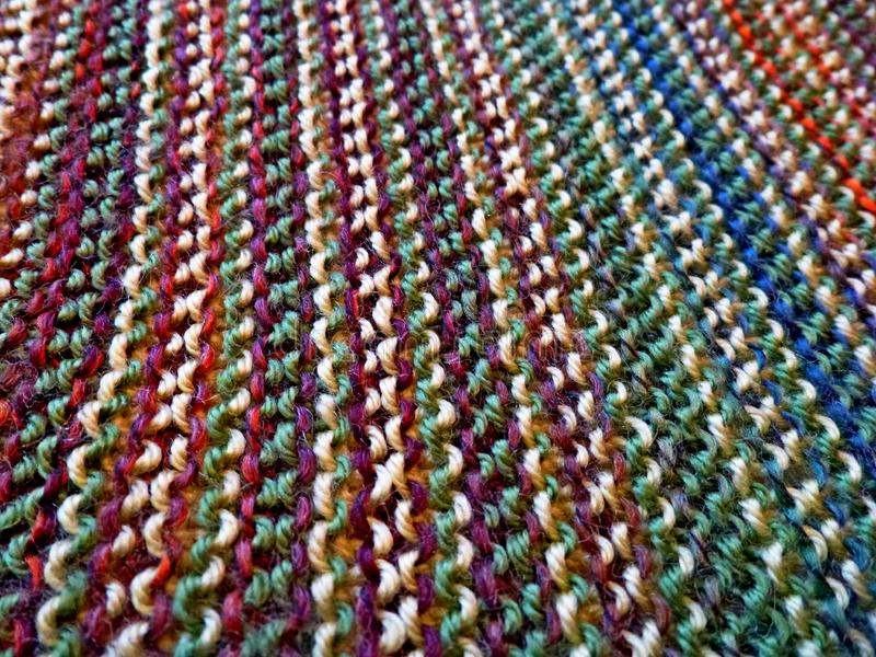 Knitting. Knitted multicolored fabric. Knitting texture. Background image. Hobbies leisure crafts stock photo