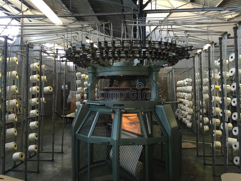 Knitting Machines Unlimited : Knitting machine creels in a factory stock image
