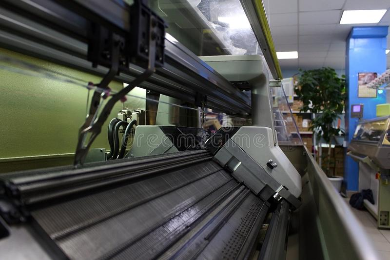 Knitting machine in the factory. Modern Knitting machine in the factory royalty free stock image