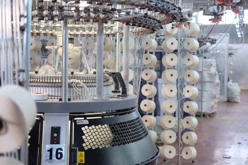 Knitting machines. Circular knitting machines textile factory stock images