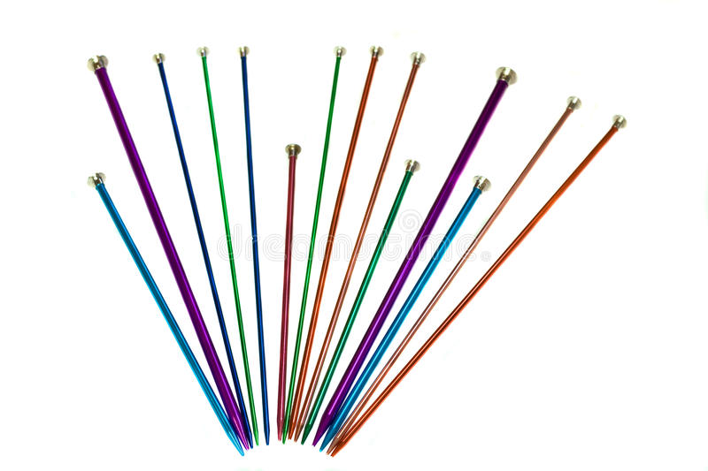 Knitting needles. A horizontal picture of a variety of knitting needles in a fan shape against an isolated white background stock photography