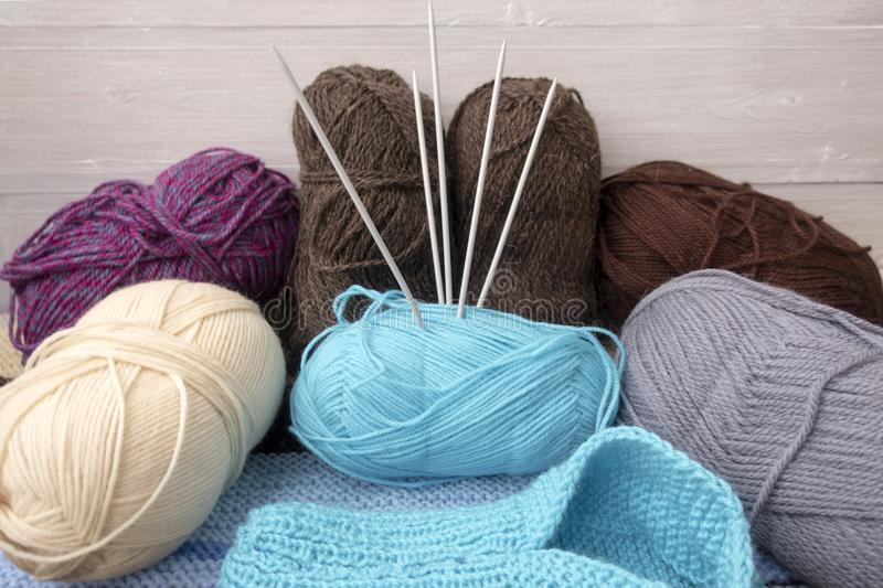 Knitting. Needles, multi-colored yarn and knitted sock stock image