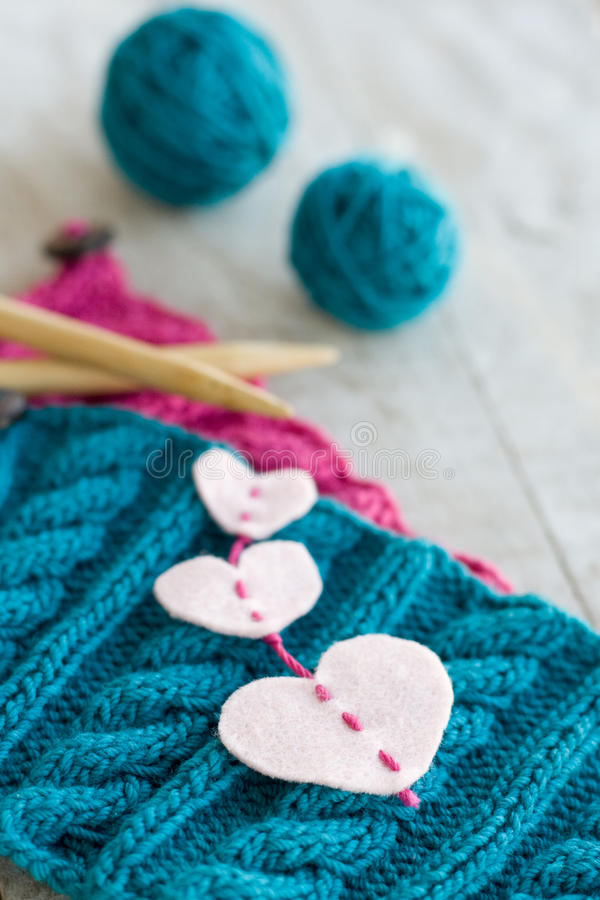 Knitting pattern and needles on a background. Knitting pattern and needles on a wooden background stock image