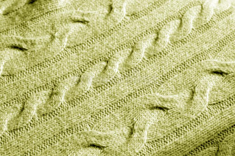 Knitting pattern in yellow tone. Abstract background and texture for design stock images