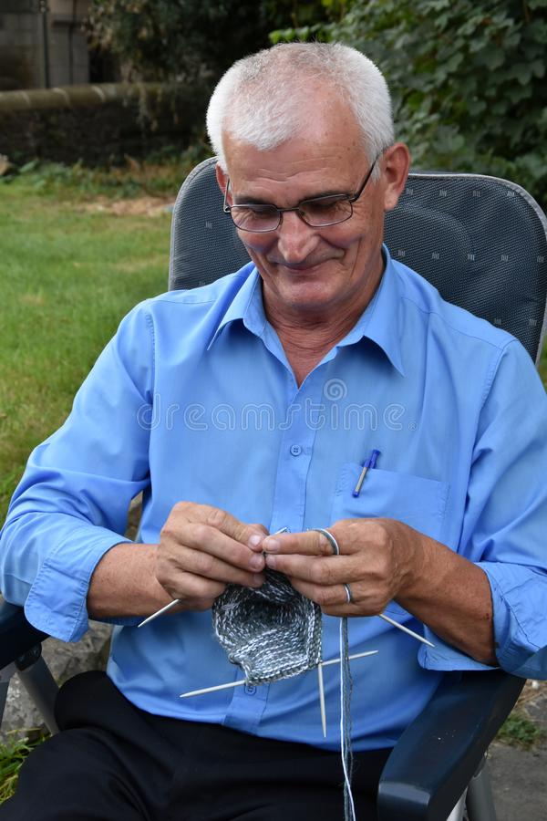 Knitting senior man stock photos