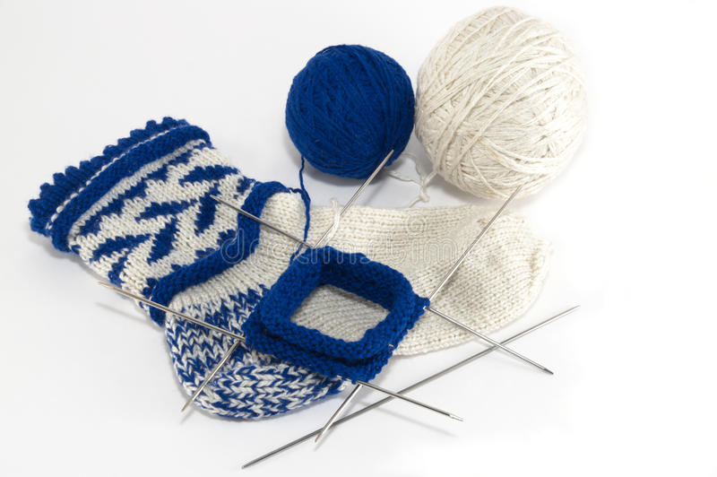 Knitting socks. On five needles royalty free stock images