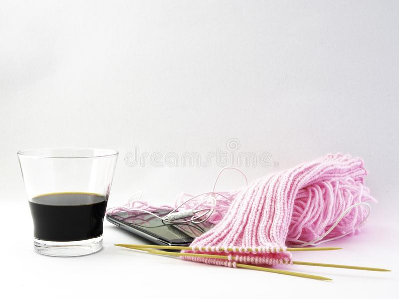 Knitting socks, a pink ball of wool is turned into socks. stock images