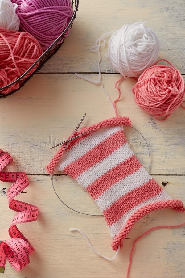 Knitting stripes with two colors of yarn stock photos