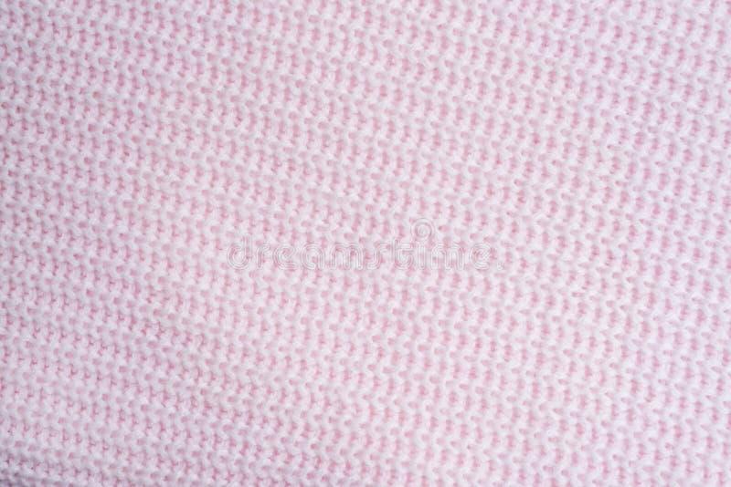 knitting Textura rosada rayada de la tela del punto, fondo hecho punto del modelo Lecho con la tela escocesa hecha punto rosa Cop fotos de archivo libres de regalías