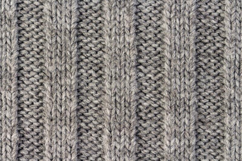 knitting Verticale gestreepte grijs breit stoffentextuur, gebreide patroonachtergrond royalty-vrije stock foto