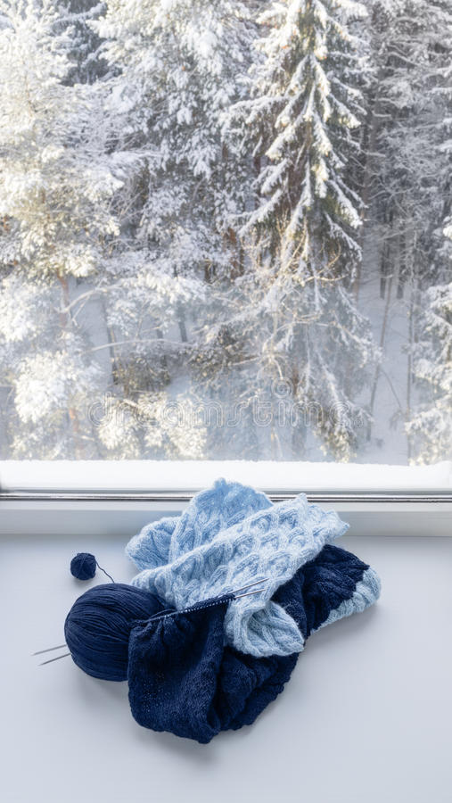 Knitting on windowsill royalty free stock image