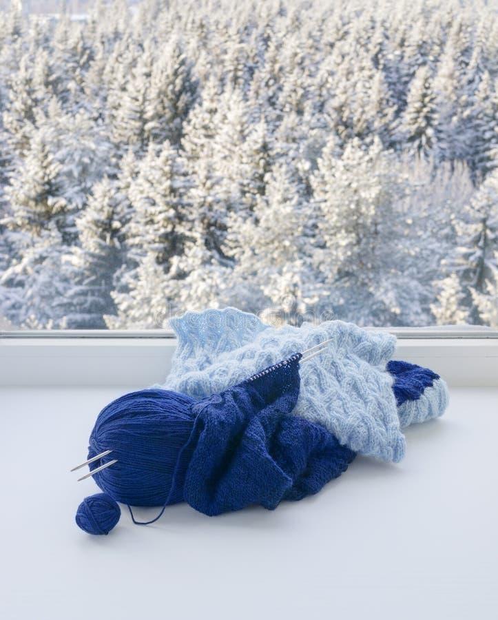 Knitting on windowsill royalty free stock photography