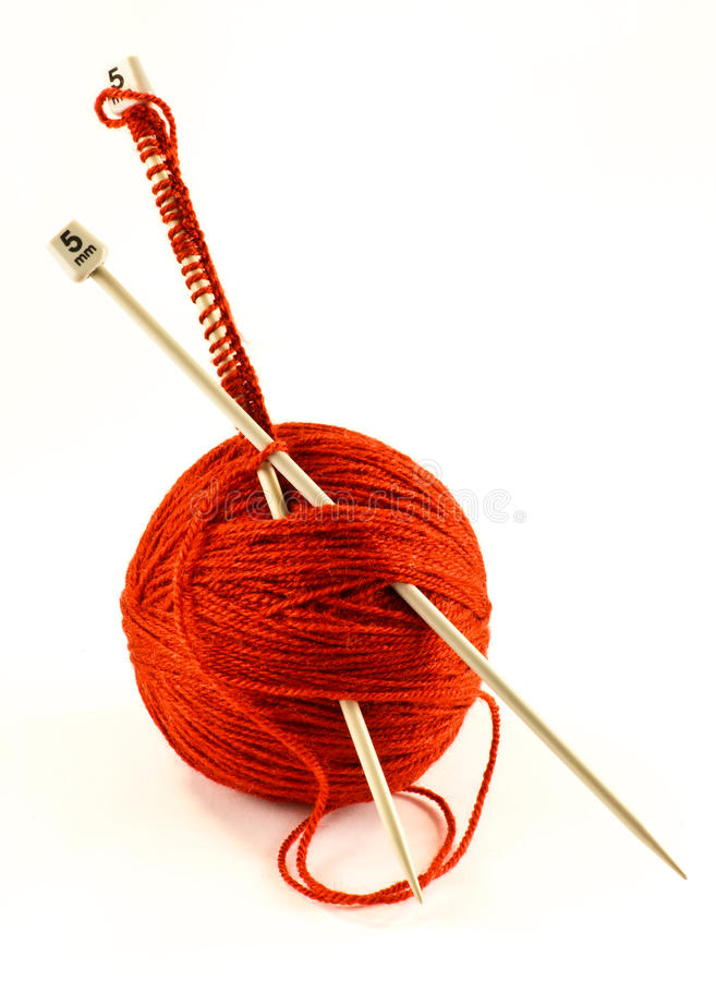 Knitting wool. Cast on knitting wool and ball with needles stock images