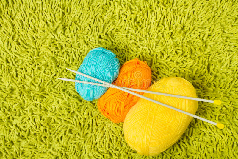Download Knitting Yarn Balls And Needles Over Green Carpet Stock Photo - Image of full, detail: 27087668