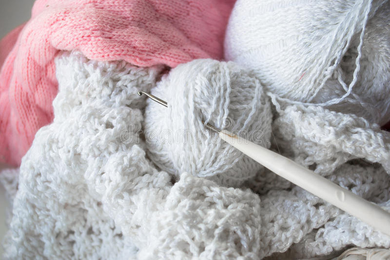 Knitting yarn balls and needles on the white wooden background. stock photography