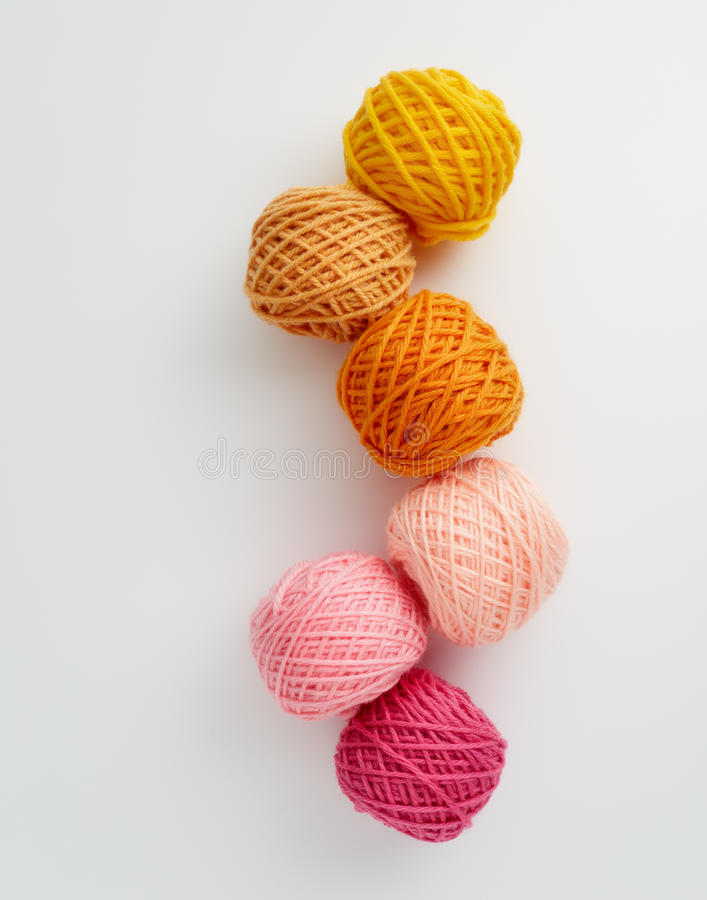 Knitting yarn balls in pink and yellow tone. royalty free stock photo