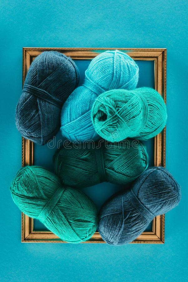 Knitting yarn with knitting needles stock photos