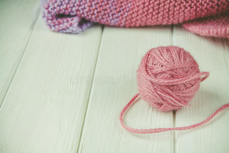 Knitting yarn rolled into balls. On a white wooden background royalty free stock photography
