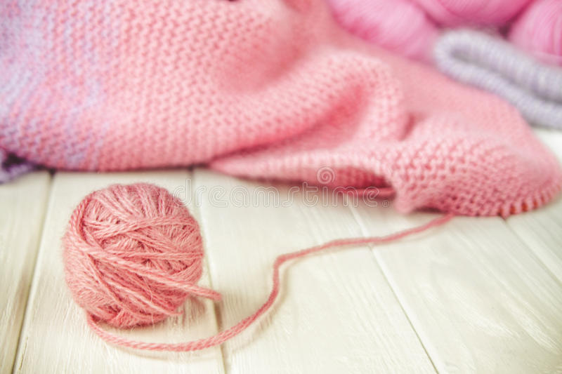 Knitting yarn rolled into balls. On a white wooden background royalty free stock photo